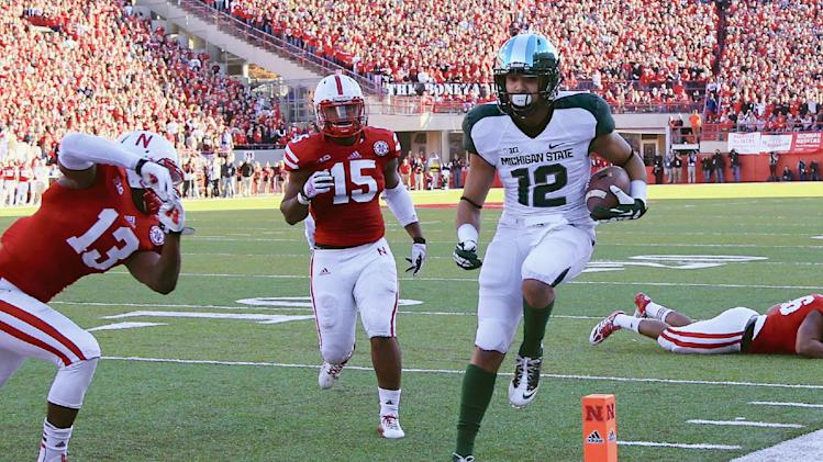 Michigan St edges closer to Big Ten title game