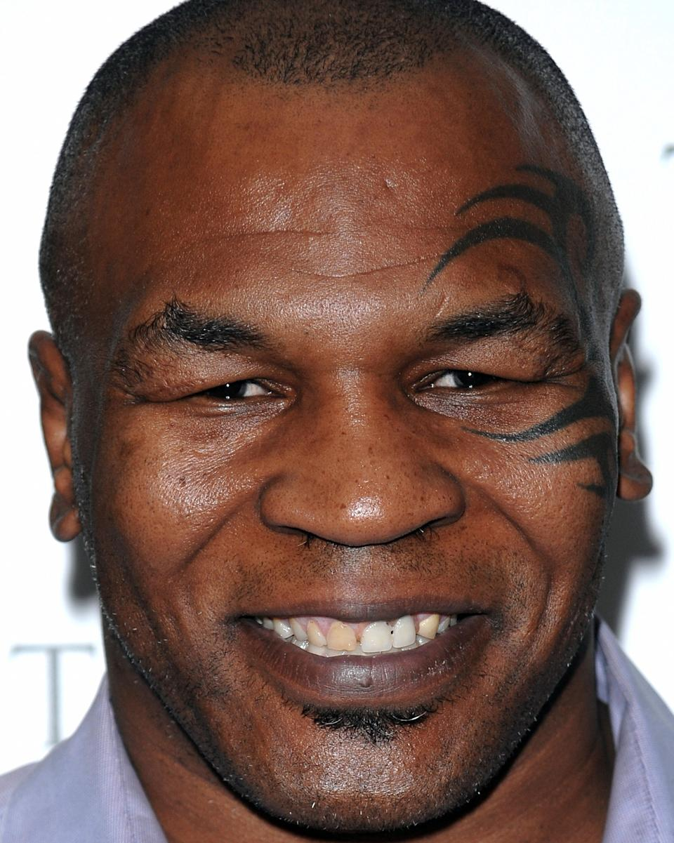 In this photo taken on April 20, 2009, former heavyweight boxing champion Mike Tyson attends a special screening of Sony Picture Classics' 'Tyson' in New York. An upstate New York wedding went an extra round when the boxing great just happened to stumble upon the wedding party posing for pictures. (AP Photo/Evan Agostini, File)