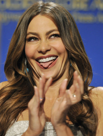 Presenter Sofia Vergara reacts onstage after she was nominated for Best Performance by an Actress in a Supporting Role in a Series, Mini-Series or Motion Picture Made for Television for &quot;Modern Family,&quot; during nominations for the 69th Annual Golden Globe Awards, Thursday, Dec. 14, 2011, in Beverly Hills, Calif. The Golden Globe Awards will be held on Sunday, Jan. 15, 2012, in Beverly Hills, Calif. (AP Photo/Chris Pizzello)