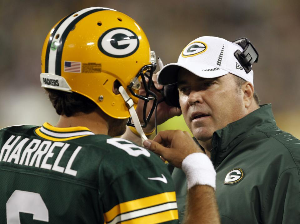 Green Bay Packers head coach Mike McCarthy talks to quarterback Graham Harrell during the first half of a preseason NFL football game against the Cleveland Browns Thursday, Aug. 16, 2012, in Green Bay, Wis. (AP Photo/Mike Roemer)