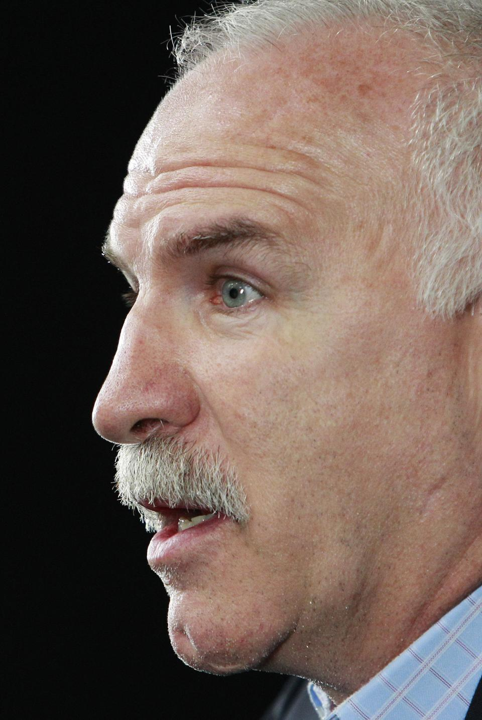 Chicago Blackhawks head coach Joel Quenneville answers a reporter's question during a media availability Sunday, June 23, 2013, in Boston. The Blackhawks will face the Boston Bruins in Game 6 of the NHL hockey Stanley Cup Final Monday night in Boston. (AP Photo/Bill Sikes)