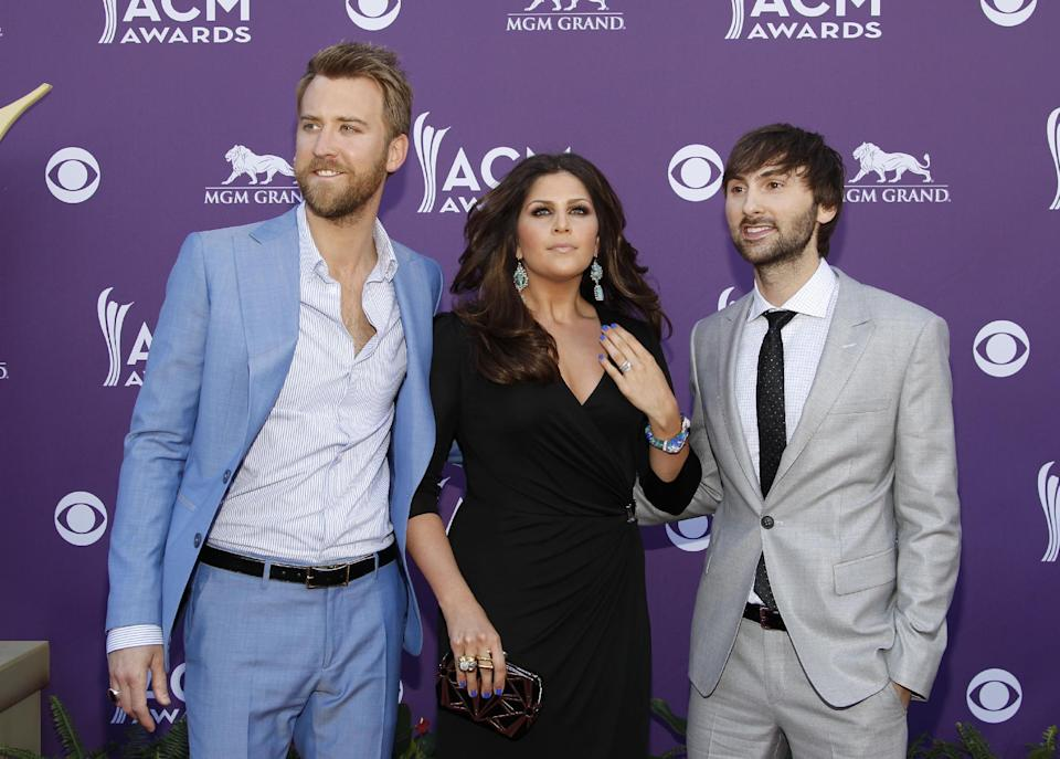 From left, Charles Kelley, Hillary Scott and Dave Haywood, of musical group Lady Antebellum, arrive at the 47th Annual Academy of Country Music Awards on Sunday, April 1, 2012 in Las Vegas. (AP Photo/Isaac Brekken)