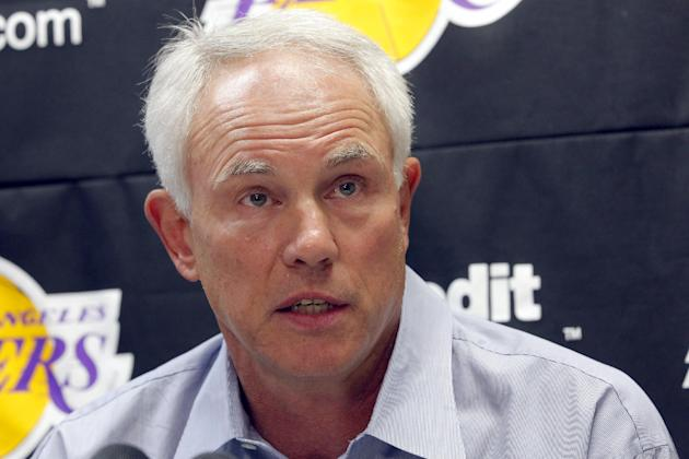 Mitch Kupchak, Los Angeles Lakers general manager, speaks to reporers about the upcoming season, Wednesday Sept. 25, 2013, in El Segundo, Calif. Kupchak says Kobe Bryant was at the NBA basketball team