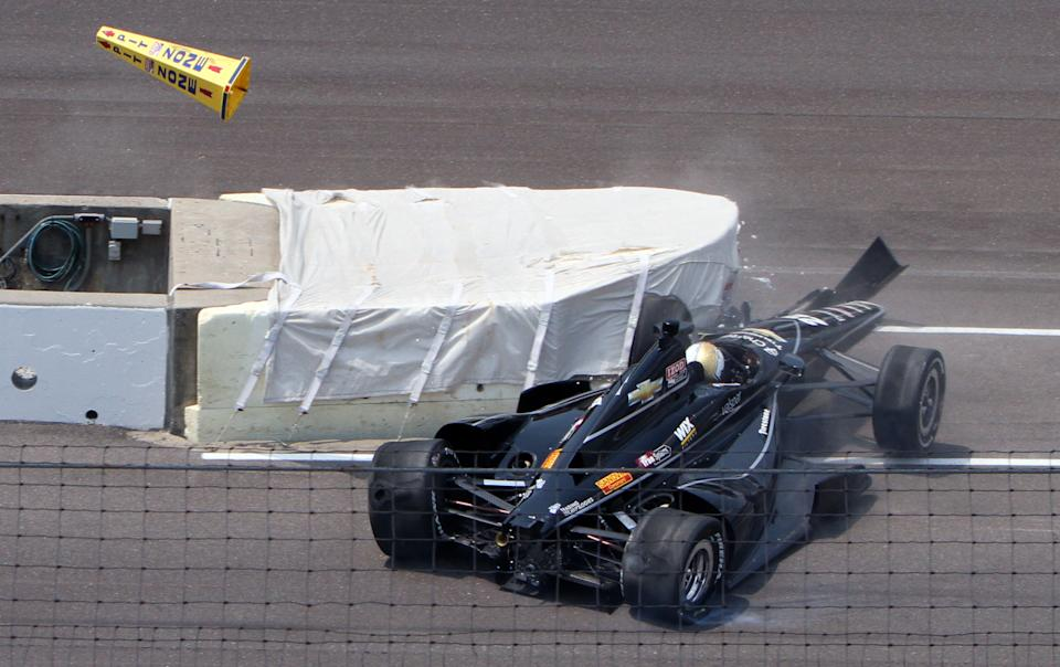 IndyCar driver Oriol Servia, of Spain, hits the wall at the entrance to the pit area on a qualification attempt during the first day of qualifications for the Indianapolis 500 auto race at the Indianapolis Motor Speedway in Indianapolis, Saturday, May 19, 2012. (AP Photo/Don Larson)