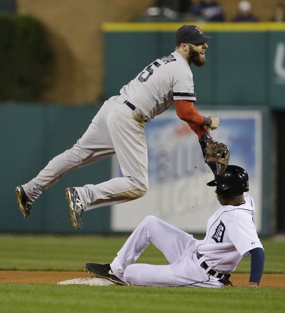 Boston Red Sox second baseman Dustin Pedroia throws to first after forcing out Detroit Tigers' Austin Jackson at second in the sixth inning during Game 4 of the American League baseball championship series Wednesday, Oct. 16, 2013, in Detroit. (AP Photo/Matt Slocum)