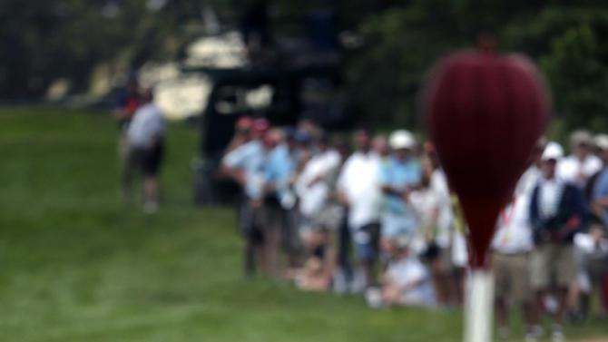 Hunter Mahan putts on the sixth hole during the fourth round of the U.S. Open golf tournament at Merion Golf Club, Sunday, June 16, 2013, in Ardmore, Pa. (AP Photo/Charlie Riedel)