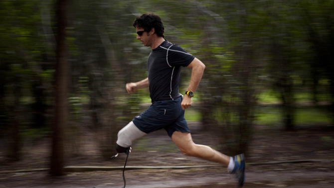 "In this Aug. 28, 2010 photo, Associated Press photographer Emilio Morenatti runs during a photo session in a Mexico City public park, one year after he lost his leg during an attack while on assignment in Afghanistan. For those who lost a limb or more in the Boston Marathon, Monday, April 15, 2013, was the day their world changed forever. Morenatti's world changed also, on Tuesday, Aug. 11, 2009, when during his embed in southern Afghanistan with the U.S. military as a photographer for The Associated Press, which was to have been his last patrol before going home, the eight-wheel armored Stryker vehicle where he was traveling in with U.S soldiers hit a roadside bomb and flipped over, knocking him unconscious. Morenatti, who lost his leg below the knee in the bomb blast, says that if those maimed in Boston were to ask him what was harder, the physical or psychological recovery, he would say the two go hand-in-hand. ""If you don't confront the feelings of loss, the fact that your world has changed, you never fully recover from the amputation,"" writes Morenatti. (AP Photo/Ramon Espinosa)"