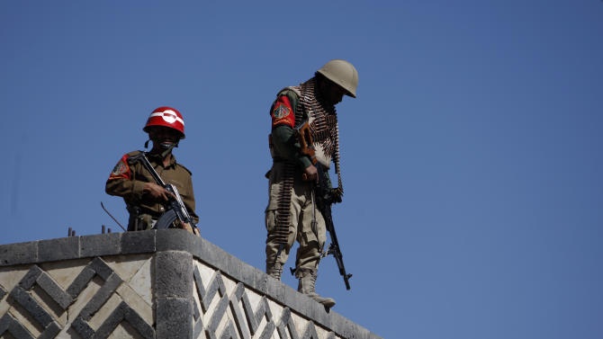 Yemeni soldiers stand guard on the rooftop of a state security court during a trial of suspected al-Qaida militants in Sanaa, Yemen, Monday, Jan. 21, 2013. A Yemen security official said an explosion Sunday in the province of Bayda has killed at least 13 suspected al-Qaida militants. (AP Photo/Hani Mohammed)