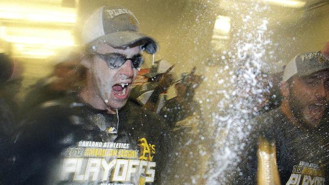 Oakland Athletics' Josh Reddick celebrates in the locker room after the team clinched a wild card berth in the American League at the end of a baseball game against the Texas Rangers on Monday, Oct. 1, 2012, in Oakland, Calif. (AP Photo/Ben Margot)