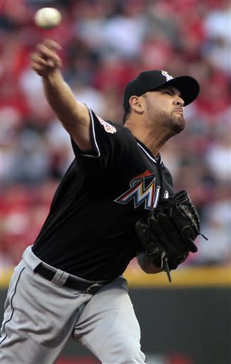 Marlins get first win, 8-3 over Reds
