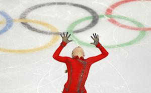 Russia wins team figure skating, 1st gold of Sochi