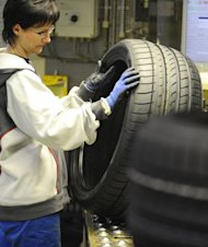 A worker in the quality control section of the Goodyear Dunlop Tires Germany GmbH plant in Fuerstenwalde inspects tires in 2010. Reducing the male-female employment gap has been an important driver of European economic growth in the last decade, the report said