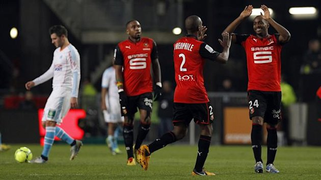 Stade Rennes' Kevin Theophile-Catherine (C) celebrates with team mates after scoring against Olympique Marseille during their French Ligue 1 soccer match at the Route de Lorient stadium in Rennes, January 26, 2013. REUTERS/Stephane Mahe (FRANCE - Tags: SP