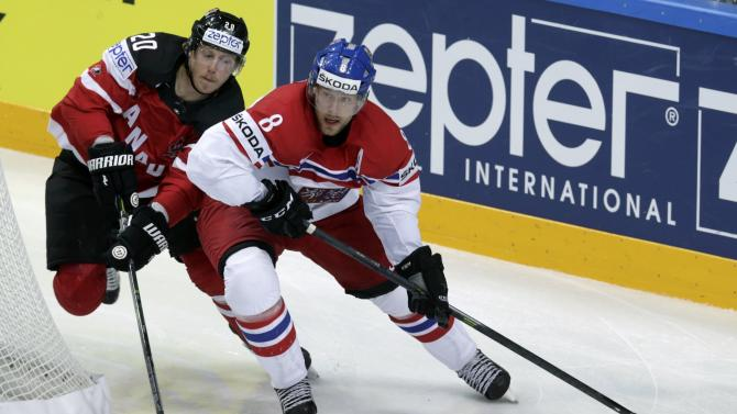 Canada's Eakin fights for the puck with Hejda of the Czech Republic during their Ice Hockey World Championship game against Sweden at the O2 arena in Prague