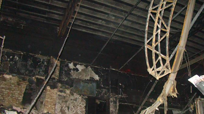 The interior of the Kiss nightclub is burned out after a fatal fire in Santa Maria, Brazil, Sunday, Jan. 27, 2013.  A fast-moving fire roared through the crowded, windowless Kiss nightclub in this southern Brazilian city early Sunday, killing more than 230 people. Many of the victims were under 20 years old, including some minors. (AP Photo/Roger Shlossmacker)