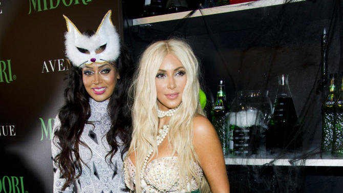 LaLa Anthony, left, and Kim Kardashian attend the 2nd Annual Midori Green Halloween Party on Saturday, Oct. 27, 2012 in New York. (Photo by Charles Sykes/Invision/AP)