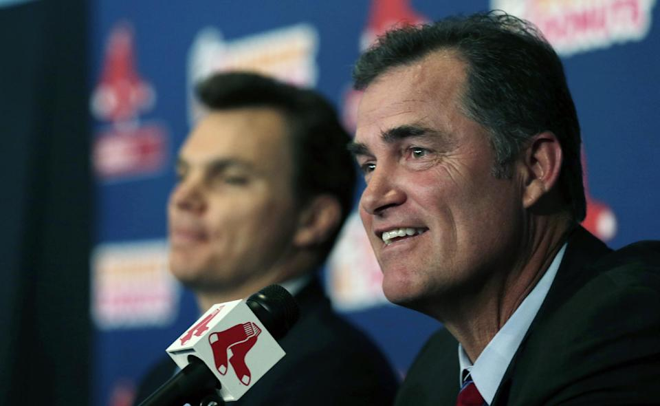 New Boston Red Sox manager John Farrell, right, smiles as he sits with general manager Ben Cherrington during a news conference at Fenway Park in Boston, Tuesday, Oct. 23, 2012.  Farrell is the 46th manager in franchise history. (AP Photo/Charles Krupa)