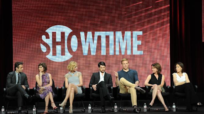 """From left, actors Michael Sheen, Lizzy Caplan, Caitlin Fitzgerald, Nicholas D'Agosto, Teddy Sears and executive producer Sarah Timberman and executive producer/writer Michelle Ashford participate in the """"Masters of Sex"""" panel at the 2013 Showtime Summer TCA Press Tour at the Beverly Hilton Hotel on Tuesday, July 30, 2013 in Beverly Hills, Calif. (Photo by Frank Micelotta/Invision/AP)"""