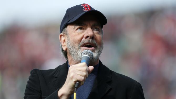 "Neil Diamond sings ""Sweet Caroline"" in the eighth inning of a baseball game between the Boston Red Sox and the Kansas City Royals in Boston, Saturday, April 20, 2013. Playing at home for the first time since two explosions at the Boston Marathon finish line killed three people and wounded more than 180 others, the Red Sox honored the victims and the survivors with a pregame ceremony and an emotional video of scenes from Monday's race. (AP Photo/Michael Dwyer)"