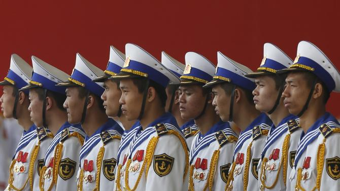 Members of the naval guard of honour stand during celebrations to commemorate the 70th anniversary of the establishment of the Vietnam People's Army in Hanoi