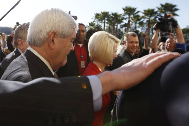 Republican presidential candidate, former House Speaker Newt Gingrich, left, and his wife Callista, center, arrive at Exciting Idlewild Baptist Church, Sunday, Jan. 29, 2012, in Lutz, Fla. (AP Photo/Matt Rourke)
