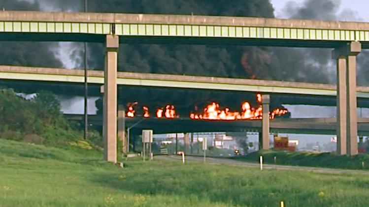 A tanker truck loaded with diesel fuel burns after it overturned along Interstate 81 near Harrisburg, Pa. on Thursday, May 9, 2013, shutting down the heavily traveled artery. The truck was headed northbound from Carlisle shortly after 6 a.m. when it flipped over on a ramp to Route 22-322 westbound, near the I-81 bridge over the Susquehanna River. State police said the driver was treated at a hospital for minor injuries. (AP Photo/TV27-David Tristan)