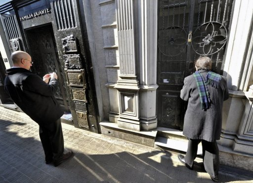 A man watches inside a crypt on sale in Buenos Aires