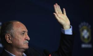 Brazilian national soccer team head coach Scolari waves during a news conference in Rio de Janeiro