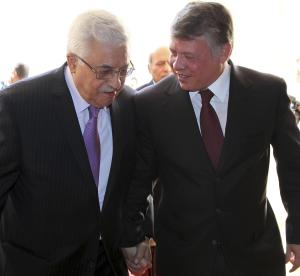 """In this photo provided by Jordanian News Agency PETRA, Palestinian President Mahmoud Abbas, left, holds hands with King Abdullah II of Jordan as they meet in Amman, Jordan, Tuesday, Jan. 10, 2012. President Abbas says talks between chief Palestinian and Israeli negotiators have provided an 'important opportunity' for reviving direct negotiations. """"We must take this chance,"""" Abbas told reporters after talks with Jordan's King Abdullah II in Amman on Tuesday. (AP Photo/PETRA)"""