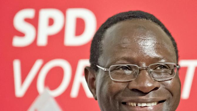 FILE - In this July 25, 2013 file picture , Karamba Diaby, a German Social Democratic Party candidate, smiles during an election campaign in Halle , Germany. The Senegal-born chemist has become the first black lawmaker to be elected to Germany's Parliament. Election authorities in the eastern state of Saxony-Anhalt said Monday Sept. 23, 2013 that Karamba Diaby won a seat in the lower house for the Social Democrats, Germany's main center-left party. The 51-year-old Diaby moved to the city of Halle in 1986, receiving a scholarship to study in East Germany at a time when communuist rule was slowly unraveling. He gained German citizenship in 2001. (AP Photo/Jens Meyer,File)