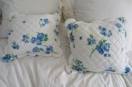 Throw pillows with freshly-washed quilted covers