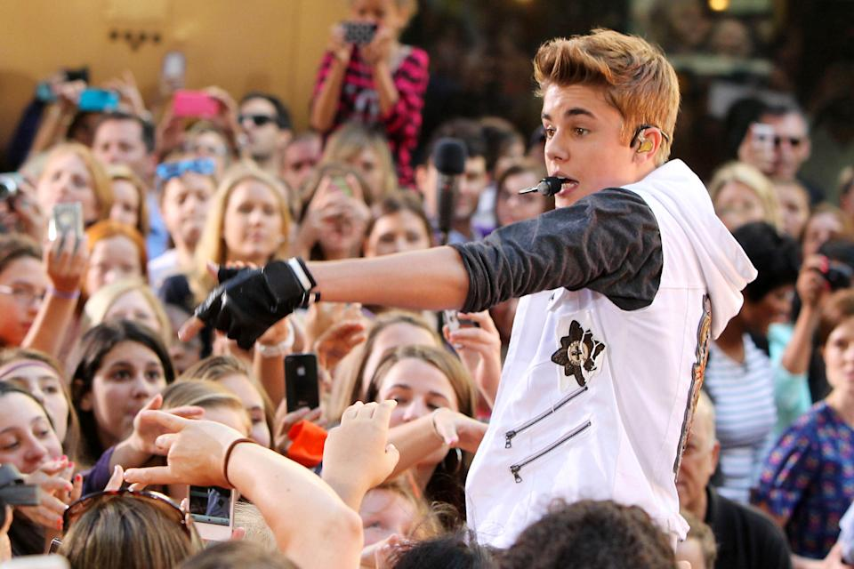 "This image released by Starpix shows singer Justin Bieber performing on the ""Today"" show as part of their summer concert series in Rockefeller Center, Friday, June 15, 2012 in New York. (AP Photo/Starpix, Amanda Schwab)"