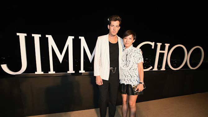 Mark Ronson, left and Sandra Choi, Jimmy Choo creative director, attend Billboard & Jimmy Choo's Men of Style on Friday, Aug. 28, 2015, in Los Angeles. (Photo by Jordan Strauss/Invision for The Hollywood Reporter/AP Images)
