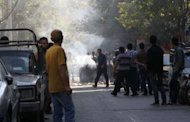 <p>Iranian protesters gather next to a burning garbage container during clashes in Tehran. Journalists for foreign media in Iran were not permitted to go to the area to confirm events there and had to rely on eyewitness accounts.</p>