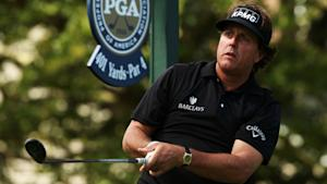 Woods and Mickelson stay stuck deep in pack