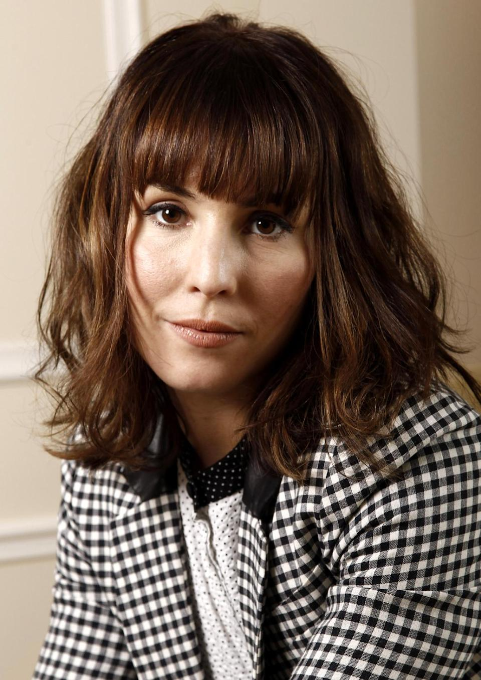 "In this Dec. 3, 2011 photo, actress Noomi Rapace, from the upcoming film ""Sherlock Holmes: A Game of Shadows"", poses for a portrait in Beverly Hills, Calif. The film opens in theaters Dec. 16, 2011. (AP Photo/Matt Sayles)"