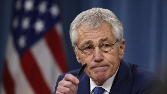 In this Dec. 19, 2013, photo, Defense Secretary Chuck Hagel takes questions as he briefs reporters at the Pentagon in Washington. Veterans groups are fighting part of the new budget deal signed into law Dec. 20 that curbs annual pension increases for military retirees under age 62. After a barrage of protests from the military community, lawmakers said they'll review the cut next year and possibly reverse it.(AP Photo/Charles Dharapak)