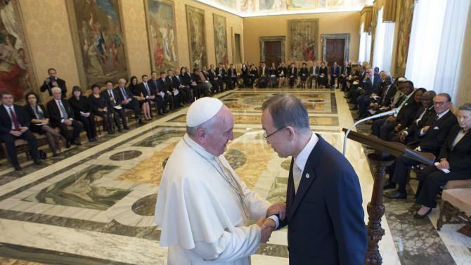 Pope Francis shakes hands with U.N. Secretary General Ban