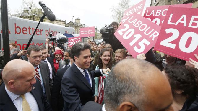 Britain's opposition Labour Party leader Ed Miliband is escorted into a campaign event  in Colne, northern England