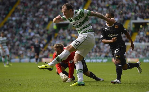 Celtic's Stokes scores against Motherwell during their Scottish Premier League soccer match at Celtic Park