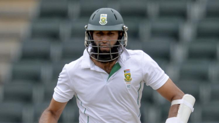 South Africa's Hashim Amla makes a run during the second day of their cricket test match against India in Johannesburg