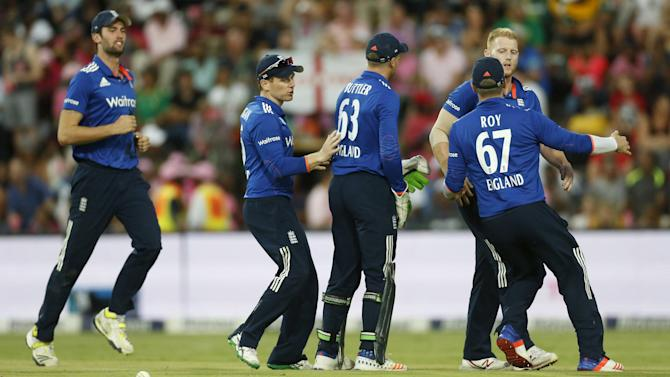 England's Ben Stokes celebrates with teammates after dismissing South Africa's Quinton de Kock during the fourth One Day International cricket match in Johannesburg