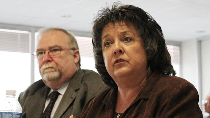 FILE - In this July 16, 2011, file photo, New Mexico Secretary of State Dianna Duran, right, talks during an interim legislative committee hearing in Albuquerque, N.M. Democratic leaders in the New Mexico House of Representatives are raising the possibility of impeachment proceedings against Duran, the state's top elections official, after allegations of fraud, embezzlement and money laundering were leveled against her. (AP Photo/Susan Montoya Bryan, File)