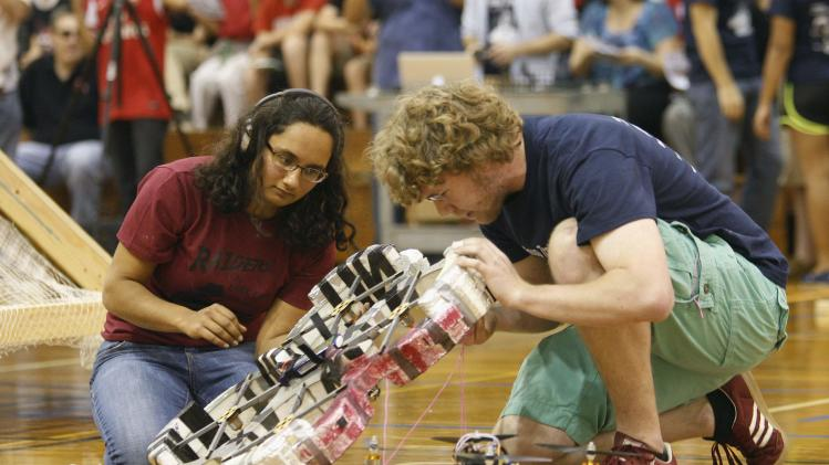 "Black Widow team member Hassenbruck-Gudipati and Cunning Stunts team member Greet untangle their quadcopters during the ""Raiders of the Lost Can""-themed robotic Engineering Design Contest at Caltech in Pasadena"
