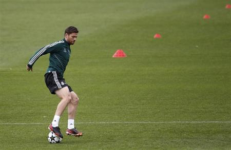 Real Madrid's Alonso controls ball during training session on eve of their Champions League semi-final second leg soccer match against Borussia Dortmund, at Valdebebas training grounds, outside Ma