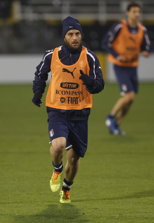 Italy's Daniele De Rossi runs during a training session at Craven Cottage in London, Sunday, Nov. 17, 2013. Italy is to play a friendly soccer match against Nigeria on Monday Nov. 18 at Craven Cottage
