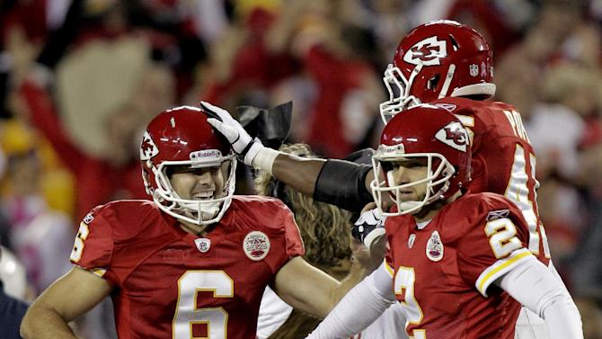 Kansas City Chiefs' Ryan Succop, left, is congratulated by teammate Leonard Pope and Dustin Colquitt (2) after kicking a 30-yard field goal to defeat the San Diego Chargers 23-20 in overtime of an NFL football game, Monday, Oct. 31, 2011, in Kansas City, Mo. (AP Photo/Charlie Riedel)