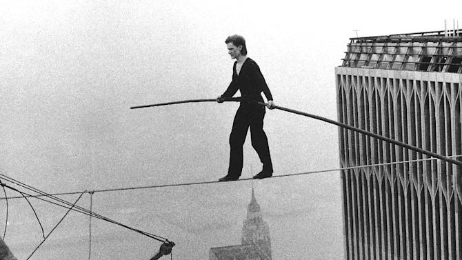"""FILE - In this Aug. 7, 1974 file photo, Philippe Petit, a French high wire artist, walks across a tightrope suspended between the World Trade Center's Twin Towers in New York.  Philippe Petit stars in """"Man on a Wire,"""" directed by James Marsh.  (AP Photo/Alan Welner, File)"""