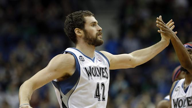 Minnesota Timberwolves' Kevin Love, left, is congratulated by Corey Brewer after a basket in the second half of an NBA basketball game against the Dallas Mavericks, Friday, Nov. 8, 2013, in Minneapolis. The Timberwolves won 116-108