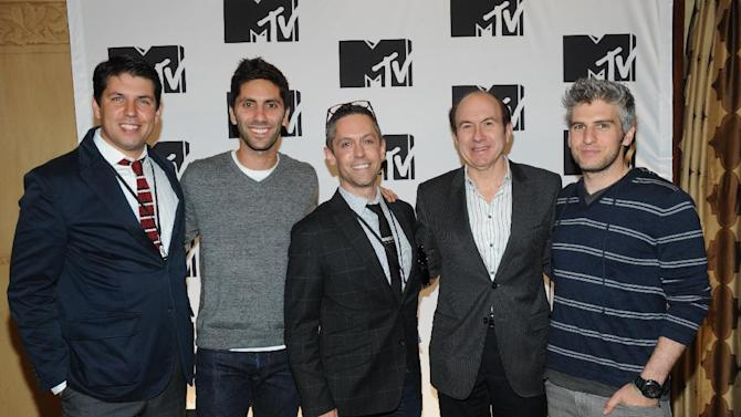 """From left, Diego Fernandez from Burger King, Nev Schulman from """"Catfish: The TV Show"""", David Jablonowski from  Starcom, Philippe Dauman President and CEO Viacom, Max Joseph from """"Catfish: The TV Show"""" arriving at the 2013 MTV Upfront, on Thursday, April 25, 2013 at the Beacon Theater in New York. (Photo by Scott Gries/Invision/AP Images)"""